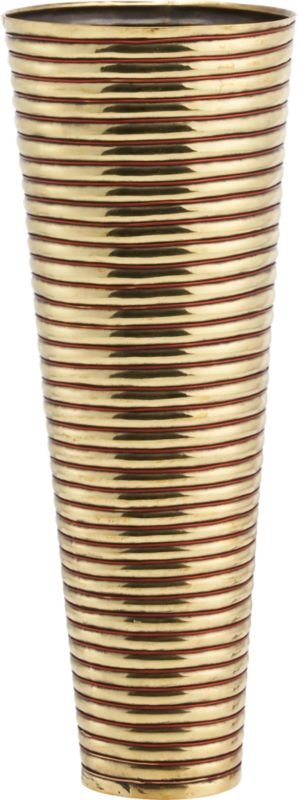 "<span class=""copyHeader"">brass rings.</span> Inspired by the coiled metal arm bands worn by the women of Rajasthan, India, this gleaming brass and copper wire vase reflects a cultural tradition. In this region, the quality and abundance of jewelry adorning the women from head to toe is indicative of a family's social status. Heated and hammered to form concentric rings, this vessel was handcrafted by traditional sheet metal artisans, known as thateras, in the small town of Rewari. Here on the outskirts of New Delhi, families have created decorative metalwork for centuries. Designer Neelima Rao observes: ""This piece keeps alive a visual vocabulary of craft.""<br /><br /><span class=""copyHeader"">neelima rao.</span> Working primarily in metal and semi-precious stones, designer Neelima Rao creates objects that are a modern reflection of India's rich tradition of art and craft. ""The combination of the decorative Indian crafts when juxtaposed with the demands of modernity and simplicity often gives rise to unexpected and unique fusion pieces,"" Rao says. Based in Faridabad, New Delhi, Rao finds inspiration in every village, town and city she travels to throughout India, each of which has its own craft or tradition of personal adornment or objects.<br /><br /><span class=""copyHeader"">CB2 Edition LMTD:</span> CB2 Edition LMTD original works are offered one time only in a small reserve. This special CB2 Edition LMTD design has a limited-edition release of 75.<br /><br /><NEWTAG/><ul><li>CB2 Edition LMTD design by Neelima Rao</li>&lt"
