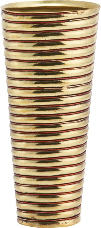 "<span class=""copyHeader"">brass rings.</span> Inspired by the coiled metal arm bands worn by the women of Rajasthan, India, this gleaming brass and copper wire vase reflects a cultural tradition. In this region, the quality and abundance of jewelry adorning the women from head to toe is indicative of a family's social status. Heated and hammered to form concentric rings, this vessel was handcrafted by traditional sheet metal artisans, known as thateras, in the small town of Rewari. Here on the outskirts of New Delhi, families have created decorative metalwork for centuries. Designer Neelima Rao observes: ""This piece keeps alive a visual vocabulary of craft.""<br /><br /><span class=""copyHeader"">neelima rao.</span> Working primarily in metal and semi-precious stones, designer Neelima Rao creates objects that are a modern reflection of India's rich tradition of art and craft. ""The combination of the decorative Indian crafts when juxtaposed with the demands of modernity and simplicity often gives rise to unexpected and unique fusion pieces,"" Rao says. Based in Faridabad, New Delhi, Rao finds inspiration in every village, town and city she travels to throughout India, each of which has its own craft or tradition of personal adornment or objects.<br /><br /><span class=""copyHeader"">CB2 Edition LMTD:</span> CB2 Edition LMTD original works are offered one time only in a small reserve. This special CB2 Edition LMTD design has a limited-edition release of 160.<br /><br /><NEWTAG/><ul><li>CB2 Edition LMTD design by Neelima Rao</l"