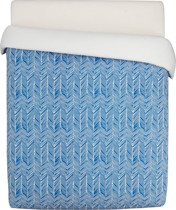 "<span class=""copyHeader"">blue zoom.</span> Bright blue linear chevrons make a graphic point against crisp white 100% cotton. Duvet has nonslip corner ties and hidden button closure. Reverses to solid white. Sleeps graphic with matching shams.<br /><br /><NEWTAG/><ul><li>100% cotton</li><li>Duvet has non-slip corner ties and hidden button closure</li><li>Reverses to white</li><li>Machine wash</li></ul>"