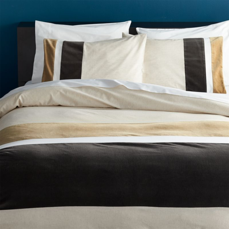 "<span class=""copyHeader"">borderline.</span> Laid-back luxe falls in line with textured bands of rich, warm neutrals. In a broad, horizontal sweep, thick velvety stripes of grey and beige align asymmetrical on off-white cotton/linen. Duvet cover has nonslip corner ties and hidden button closure. Reverses to solid off-white.?Dreamy with matching shams.<br /><br /><NEWTAG/><ul><li>Cotton/linen</li><li>Reverses to off-white</li><li>Nonslip corner ties and hidden button closure</li><li>Machine wash</li></ul>"