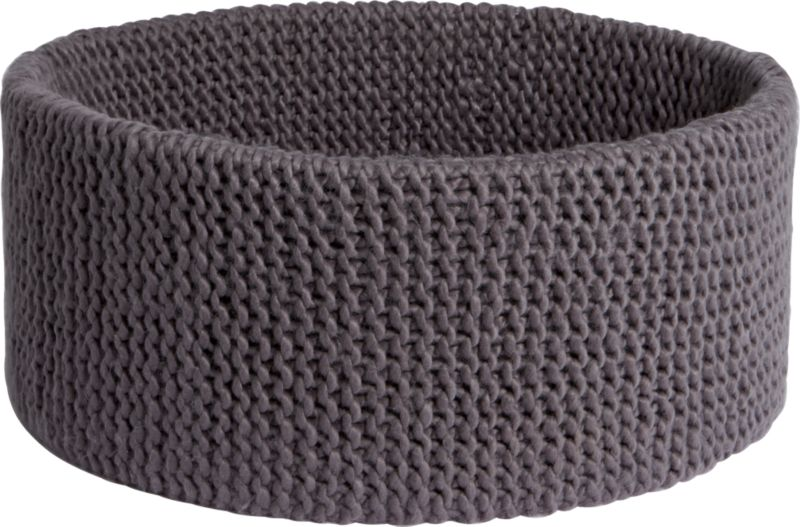 "<span class=""copyHeader"">knitting circle.</span> Chunky handwoven crochet round nests clothes, towels, blankets, toys. Dark grey basket cozies up with enough depth to conceal clutter.<br /><br /><NEWTAG/><ul><li>Handwoven crochet</li><li>100% acrylic</li><li>Hand wash in cold water, air dry</li></ul><br />"