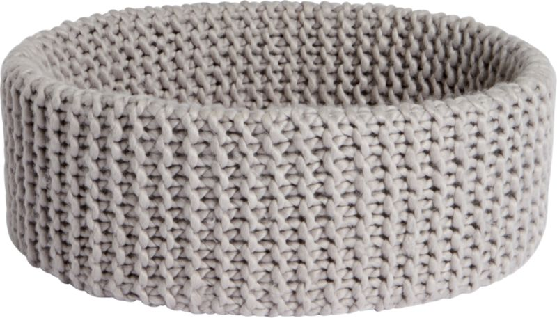 "<span class=""copyHeader"">knitting circle.</span> Chunky handwoven crochet round nests clothes, towels, blankets, toys. Light grey basket cozies up with enough depth to conceal clutter.<br /><br /><NEWTAG/><ul><li>Handwoven crochet</li><li>100% acrylic</li><li>Hand wash in cold water, air dry</li></ul><br />"