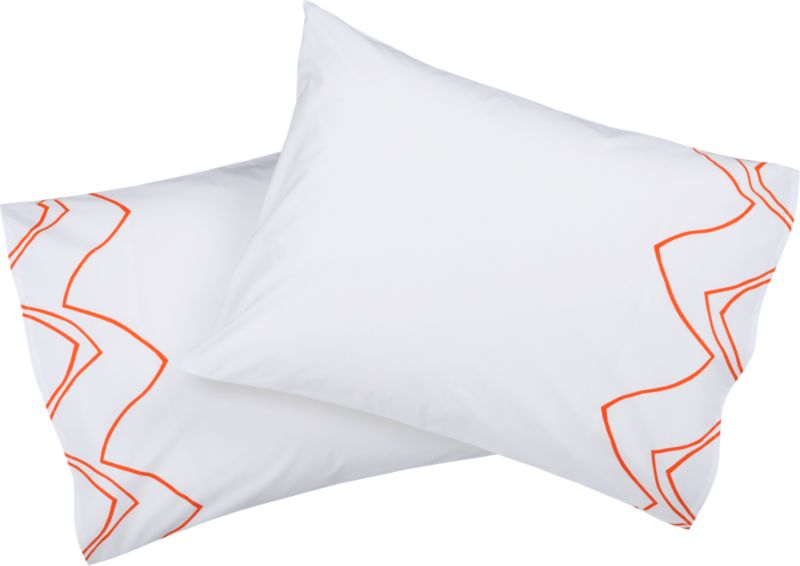 "<span class=""copyHeader"">chat line.</span> Chicago-based designer Noël Ashby gets the conversation started with a graphic tangle of bold orange lines on brite white 200-thread-count organic cotton. Ashby translated the rhythmic hum and pulse of conversation into an expressive abstraction of nonstop chatter, the words disappearing into a network of visual noise. Mostly white shams zig and zag with matching pattern on outer edge, both sides. Finished neat with envelope closure.<br /><br /><NEWTAG/><ul><li>Designed by Noël Ashby</li><li>100% cotton percale</li><li>200 thread count</li><li>Shams have envelope closure</li><li>Reverse to matching pattern</li><li>Machine wash</li></ul>"