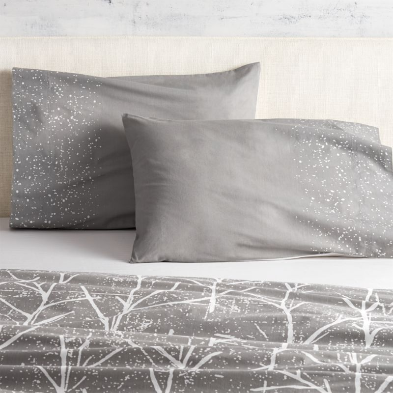 "<span class=""copyHeader"">branch out.</span> Painterly dots of white cascade over a field of grey as part of the modern forest imagined by Chicago-based designer Noël Ashby. Soft 200-thread-count cotton shams are finished neat with envelope closures; reverse to white. Dreamy with coordinating crumpled trees duvet cover.<br /><br /><NEWTAG/><ul><li>Designed exclusively for CB2 by Noël Ashby</li><li>100% cotton</li><li>200 thread count</li><li>Shams have envelope closure; reverse to white</li><li>Machine wash; do not dry clean</li></ul>"