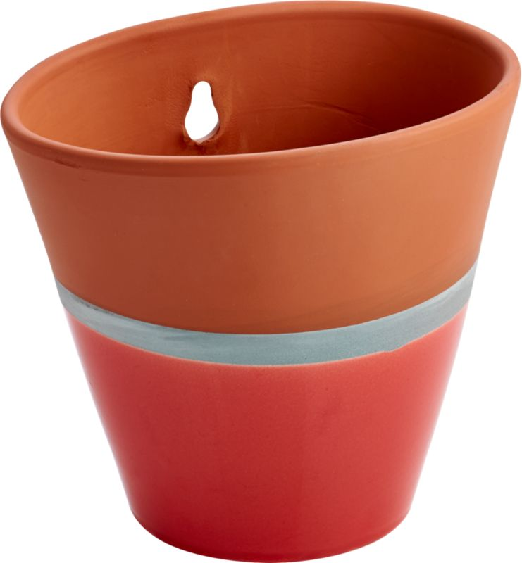 "<span class=""copyHeader"">hot dip.</span> Handmade by Portuguese artisans, terracotta vessel is fired and dipped to color block effect. Slick neon peach glaze pops in modern contrast to earthy matte terracotta, separated by a slim silvery band. Suspends greens from back cutout.<br /><br /><NEWTAG/><ul><li>Handmade</li><li>Terracotta</li><li>Partially dip-glazed peach</li><li>Cutout for easy hanging</li><li>Indoor/outdoor use</li><li>Wipe with clean, damp cloth</li></ul><br />"