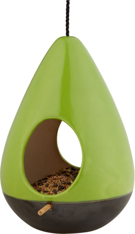 fly by green bird feeder