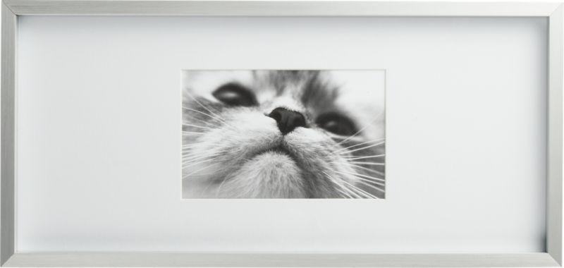 "<span class=""copyHeader"">up the art.</span> Brushed aluminum frames an XL white matsfor gallery presentation of photos or images. Rectangle hosts 4x6s.<br /><br /><NEWTAG/><ul><li>Aluminum and glass</li><li>White mat</li><li>Display alone or in multiples</li><li>Hang on wall or stand on table</li></ul>"