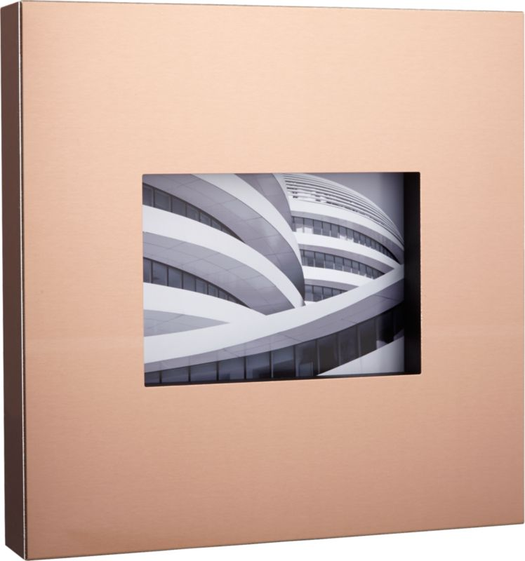 "<span class=""copyHeader"">modern metallic.</span> Finished in coppery matte rose gold, architectural steel square insets a 5""x7"" photo. Freestands or frames the wall with broad, overscaled border. Capture a modern moment with kat neon peach 5""x7"" frame.<br /><br /><NEWTAG/><ul><li>Steel frame</li><li>Copper/rose-gold powdercoat finish</li><li>Glass cover</li><li>Holds 5""x7"" photo</li><li>Wipe with soft, dry cloth</li></ul>"