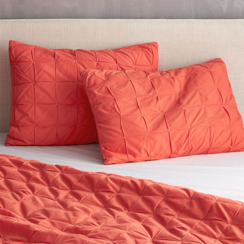 "<span class=""copyHeader"">grid block.</span> Handstitched shams square up textural blocks in a pop of red-orange. 100% cotton shams have back tie closures.<br /><br /><NEWTAG/><ul><li>Handstitched</li><li>100% cotton</li><li>100% poly fill</li><li>Shams have tie closures</li><li>Shams reverse to red-orange</li><li>Machine wash</li></ul>"