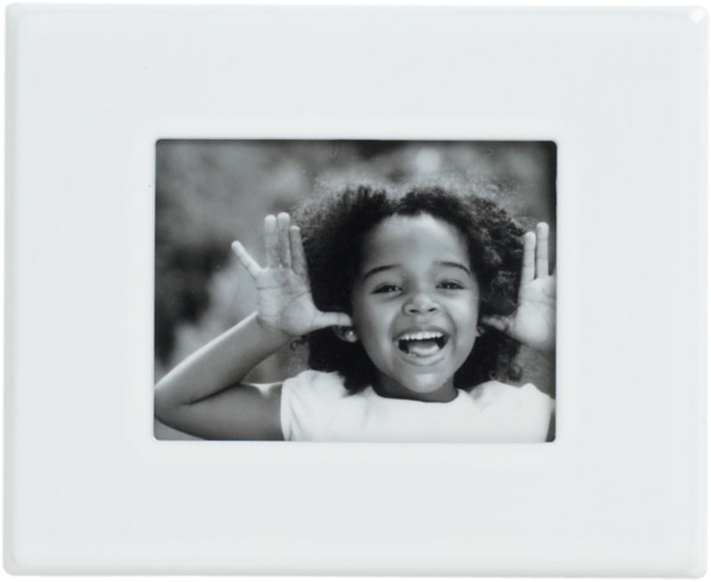 """<span class=""""copyHeader"""">snap to it.</span> Upgrade the photo gallery on your fridge. Aluminum frame painted brite white clicks to any magnetic surface to display a 1.25""""x1.5"""" pic. Hang horizontal, vertical or diagonal—any way that sticks with you.<br /><br /><NEWTAG/><ul><li>Painted aluminum frame</li><li>Magnetic backing</li><li>Holds 1.25""""Wx1.5""""H photo</li></ul><br />"""