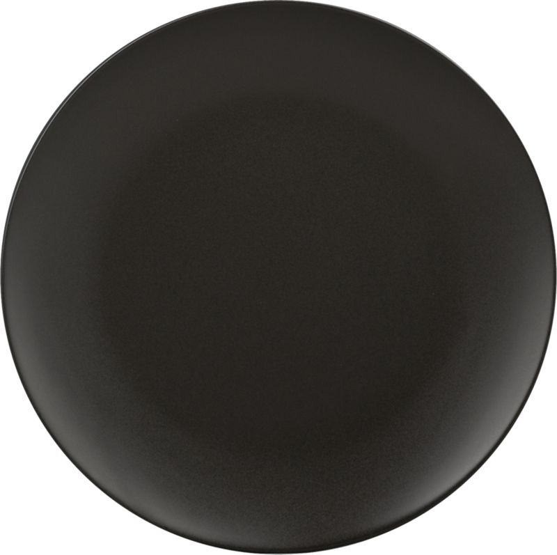 "<span class=""copyHeader"">black out.</span> Dramatic round plates up a bold presentation that makes food pop in matte black stoneware with soft curved rim. All-black wardrobe goes with everything, so layer with whiteware, prints, metallics.<br /><br /><NEWTAG/><ul><li>Porcelain</li><li>Matte black glaze</li><li>Dishwasher- and microwave-safe</li></ul>"