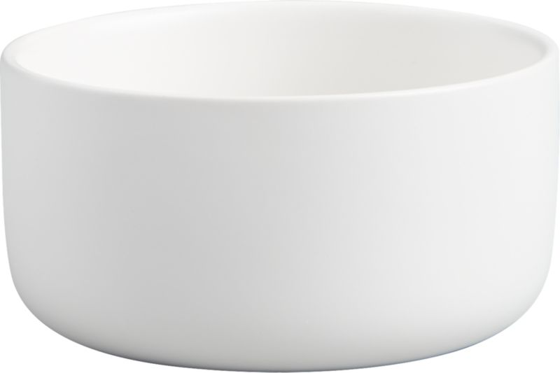 "<span class=""copyHeader"">deep dish.</span> Brite white round tops the table as one part minimalist sculpture, one part serves-it-all bowl. Handmade of stoneware glazed matte white inside and out, modern design has high sides and smooth contours to dish everything from salad to pasta.<br /><br /><NEWTAG/><ul><li>Handmade</li><li>Stoneware with matte white glaze</li><li>Dishwasher-, microwave- and oven-safe</li></ul>"