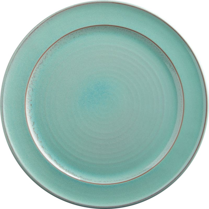 "<span class=""copyHeader"">play on clay.</span> Rimmed terracotta round reveals the warmth of clay through soft aqua reactive glaze that makes each unique. Dines in cool contrast to react orange salad plate.<br /><br /><NEWTAG/><ul><li>Terracotta</li><li>Aqua reactive glaze; each is unique</li><li>Microwave- and oven-safe</li><li>Hand wash</li></ul>"