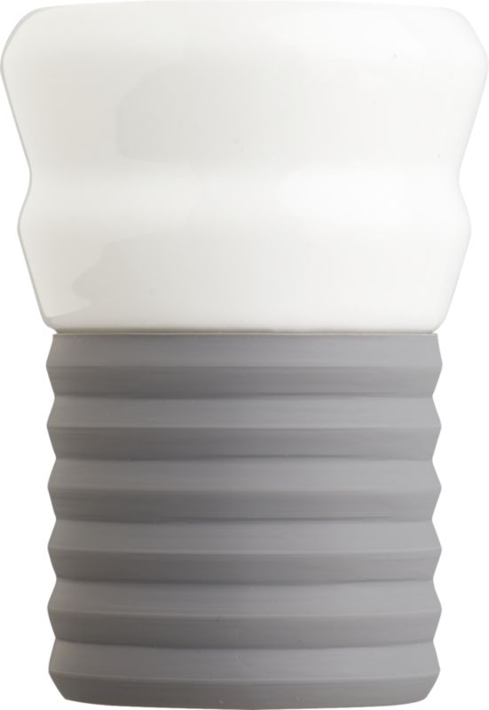 "<span class=""copyHeader"">espresso yourself.</span> Add a shot of color to your morning or nightly caffeine routine. Hand-dipped porcelain cup tucks into removable ribbed silicone bottom in subdued grey. Ridged grip feels good in the hand.<br /><br /><NEWTAG/><ul><li>Hand-dipped porcelain</li><li>Removable ribbed silicon base</li><li>Dishwasher-safe</li></ul><br />"