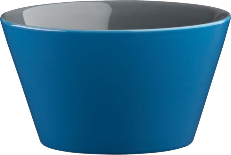 "<span class=""copyHeader"">bowled over.</span> Two-tone stoneware bowl is a colorful character, inside and out. Hi-gloss blue exterior plays bold off grey interior to pop everything from soup to nuts. Handmade dish with deep, angled sides stacks to store.<br /><br /><NEWTAG/><ul><li>Handmade</li><li>Glazed stoneware</li><li>Blue exterior; grey interior</li><li>Stackable</li><li>Dishwasher- and microwave-safe; oven-safe at 350-degrees up to two hours</li></ul>"