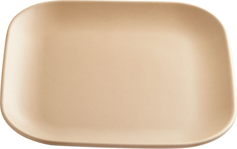 "<span class=""copyHeader"">neutral territory.</span> Modern-retro shape dines refined in neutral matte tan. Handmade of stoneware, soft square with rounded edges is a natural match for undertone grey dinner plate.<br /><br /><NEWTAG/><ul><li>Handmade</li><li>Stoneware with matte tan glaze</li><li>Dishwasher-, microwave- and oven-safe</li></ul>"
